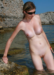 A bikini lady going topless on the La Joya Nude Image 5