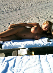 A bikini lady going topless on the La Joya Nude Image 12
