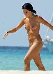 A bikini babe going topless on the Negril Image 2
