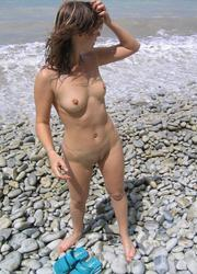 A shaved slut at the Cap d'Agde Image 4