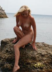 A nude posing at the Matira Image 8