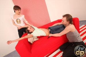 Cute young gay gets his tight butthole double penetrated on a newly bought sofa by two nasty young gays. Image 1