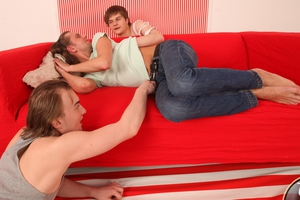Handsome guy has his sweet ass-hole double drilled by two nasty girlks on a new sofa. Image 1