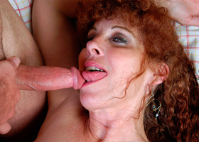 A mature slut showing off her mother-naked body Image 8