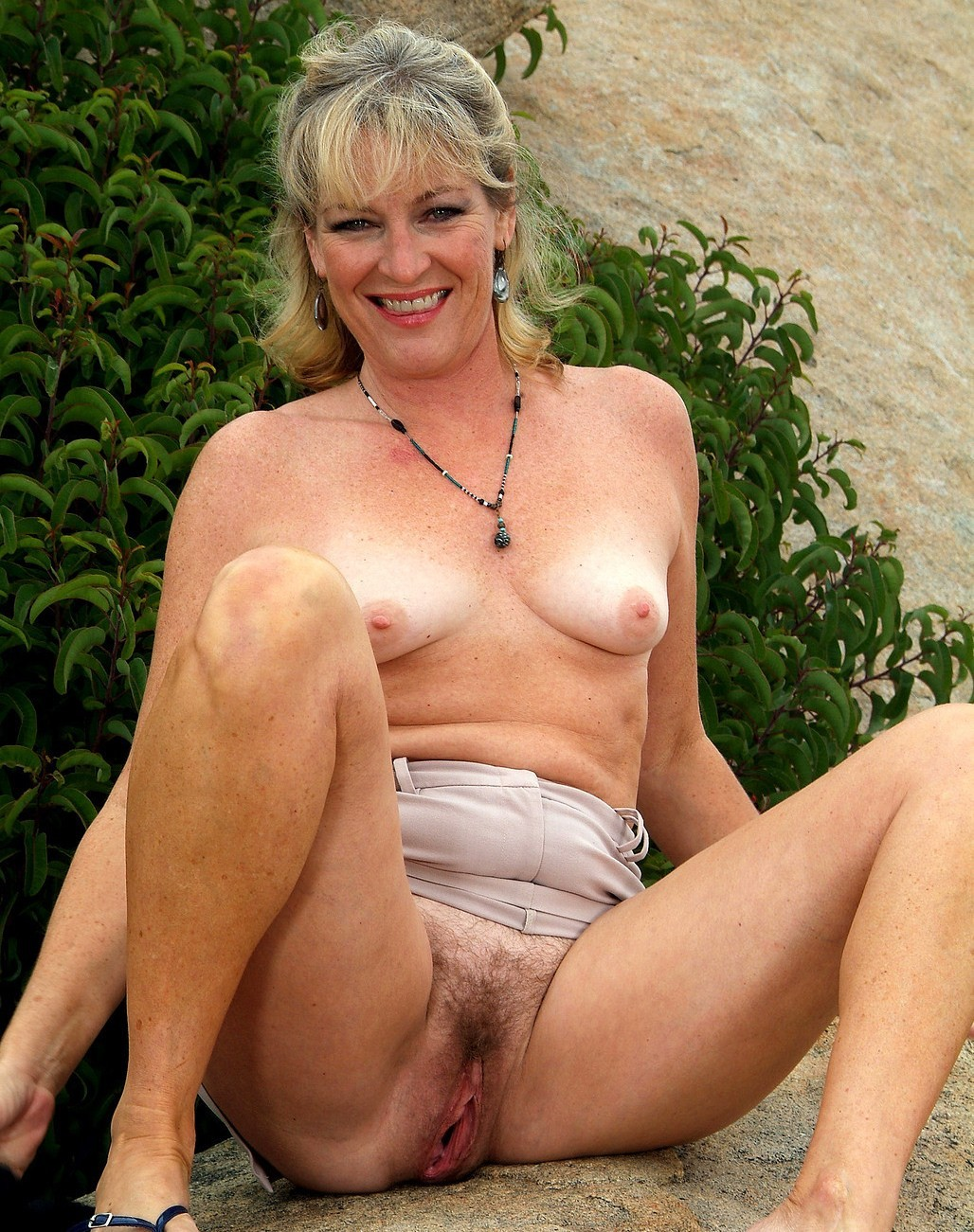 Over 70 granny with hairy pussy fucks a dildo 7