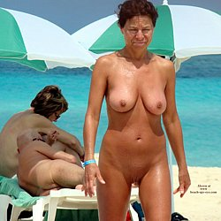 Nude mature woman at nudist beach