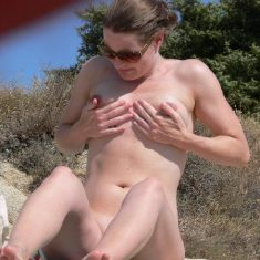 Voyeur photo of nude female on beach