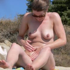 Fem. nudist at nude beach