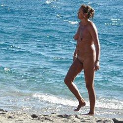 Nude mature woman at nudist beaches photos