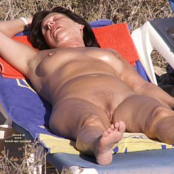 Nudist mature woman at nude beach