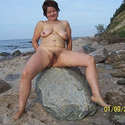Photo of Nude mature woman at nudist beach