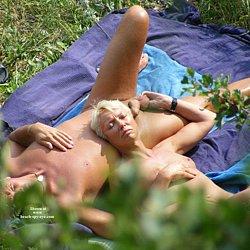 Photo of Nude mature woman at nudist beach