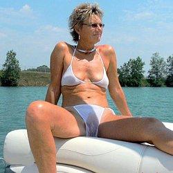 Nudist mature woman at nude beach