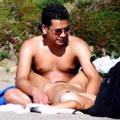 Voyeur photo of nude female on beach